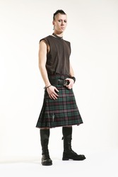 Portrait of a young punk with scottish skirt
