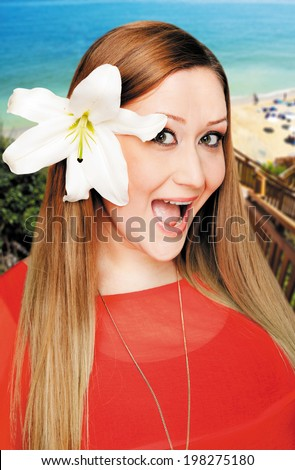 Portrait of a young reacting woman with lilly in hair on beach vacation. Work path.