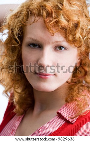 Portrait of a young red-haired woman looking into the camera
