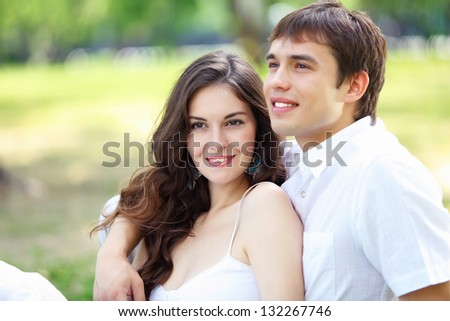 Portrait of a young romantic couple embracing each other