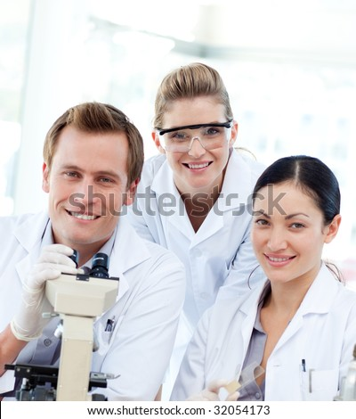 Portrait of a young scientists with a microscope