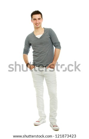 Portrait of a young smiling guy with hands in pockets , isolated on white background
