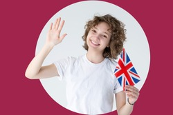 Portrait of a young smiling woman with the flag of Great Britain in a circle on a red background. Advertising concept for English courses.