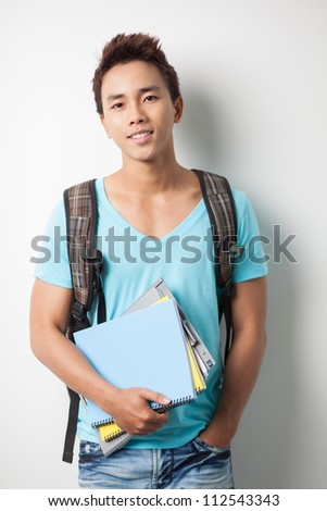 Portrait of a young student boy looking at camera