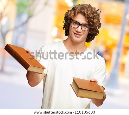Portrait Of A Young Student Holding Books, Outdoor