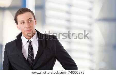 Portrait of a young successful businessman. Blurred background.