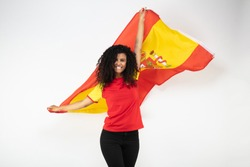 Portrait of a young supporter of the Spanish team wearing the national flag