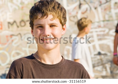 stock photo : portrait of a young teen boy, background is his friends ...
