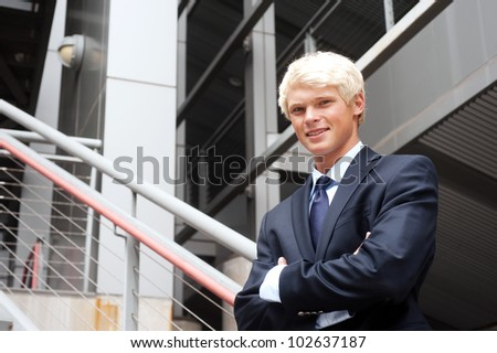 portrait of a young teenage boy in a suit shot on location