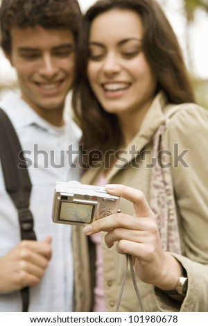Portrait of a young tourist couple taking a picture of themselves on vacations.