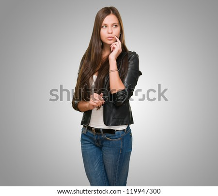 Portrait Of A Young Woman against a grey background