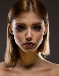 Portrait of a young woman, Big eyes, plump lips, freckles.