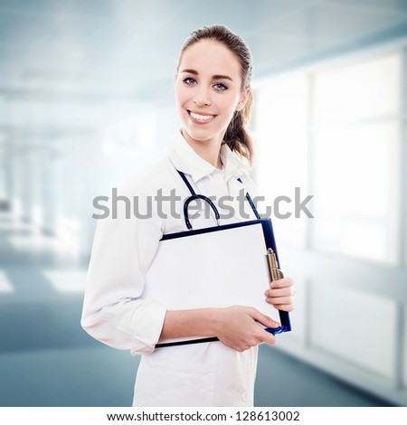 Portrait Of a Young Woman Doctor At The Hospital.