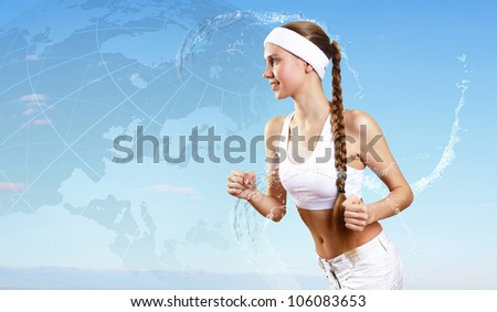 Portrait of a young woman doing sport with a bottle of pure water