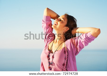 Portrait of a young woman feeling free against blue sky copyspace