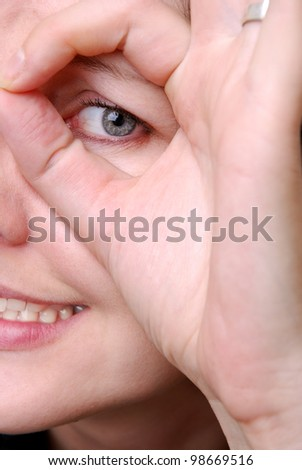 portrait of a young woman focusing something - stock photo