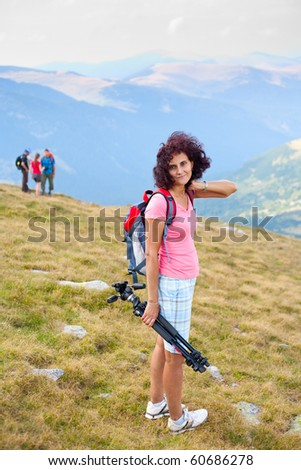 Portrait of a young woman hiking in mountains