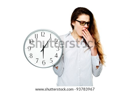 Portrait of a Young woman holding a clock in hand on white background