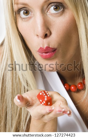 Portrait of a young woman holding a pair of dice