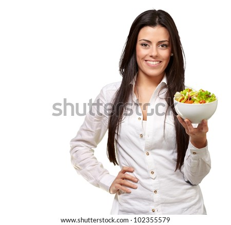 portrait of a young woman holding a salad over a white background
