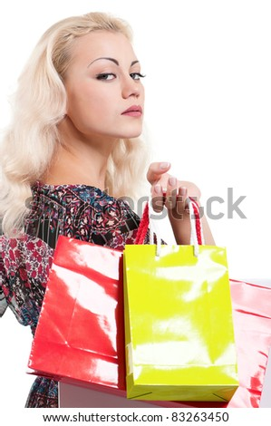 Portrait of a young woman holding a shopping bags over white background