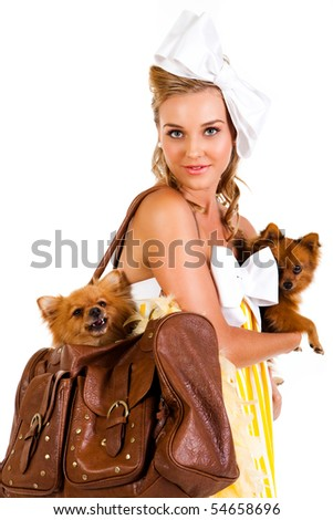 Portrait of a young woman holding a small dog. She is dressed in a yellow, striped dress. Vertical shot. Isolated on white.