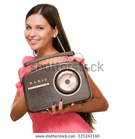 Portrait Of A Young Woman Holding Radio On White Background