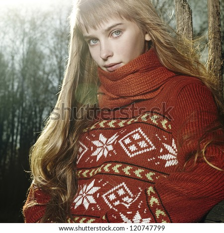 portrait of a young woman in a wool sweater in nature, spring autumn fashion