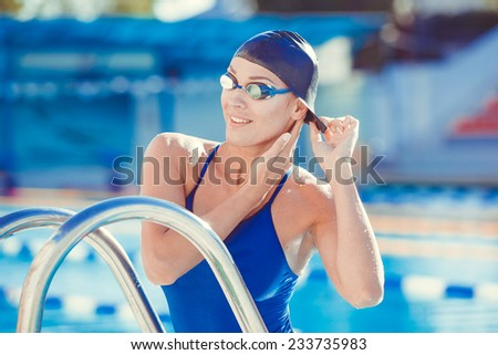 Portrait of a young woman in goggles and swimming cap
