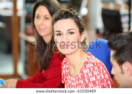 Portrait of a young woman in office