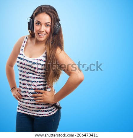 portrait of a young woman listening to music with a vintage headphones
