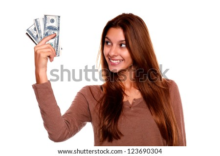 Portrait of a young woman looking to right hand with cash money with long brow hair against white background