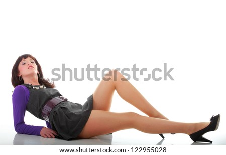 Portrait of a young woman lying on the floor isolated on white background