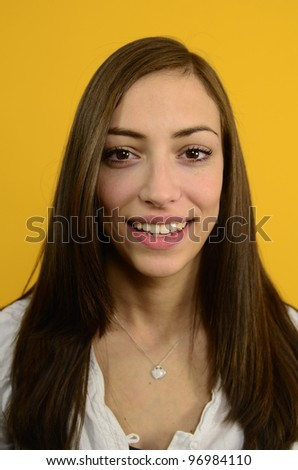 portrait of a young woman on yellow background