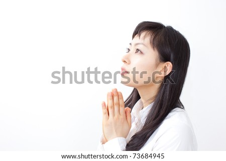 portrait of a young woman praying isolated on white background