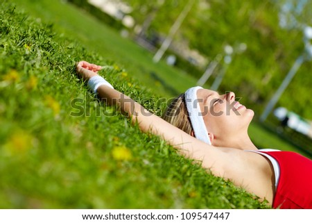 Portrait of a young woman relaxing outdoors