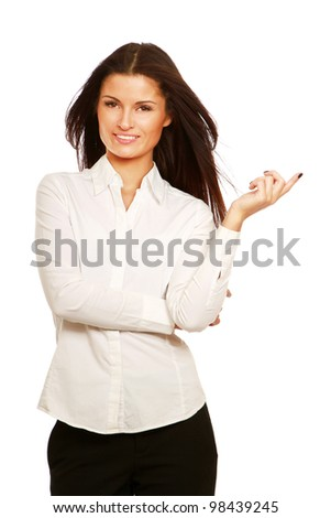 Portrait of a young woman showing something isolated on white background
