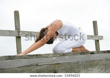 Portrait of a young woman stretching