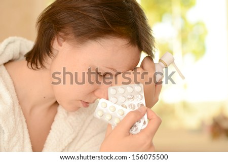 Portrait of a young woman taking pills