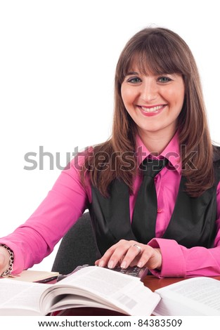 Portrait of a young woman using a calculator