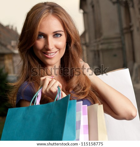 Portrait of a young woman who returns from shopping