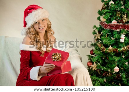 Portrait of a young woman with a Christmas gift