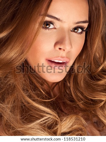 Portrait of a young woman with beautiful hair and eyes