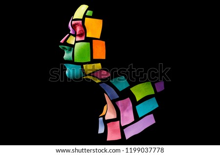 Portrait of a young woman with bold glowing makeup posing in the studio. Shape of colored squares on woman face. Isolated on black background. #1199037778