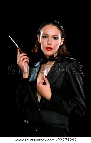 Portrait of a young woman with cigarette - stock photo