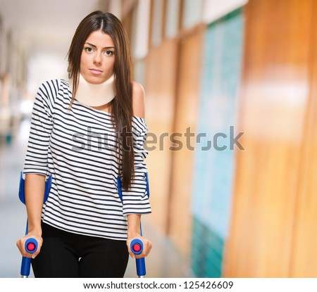 Portrait Of A Young Woman With Crutches, indoor