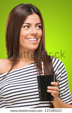 Portrait Of A Young Woman With Cup against a green background