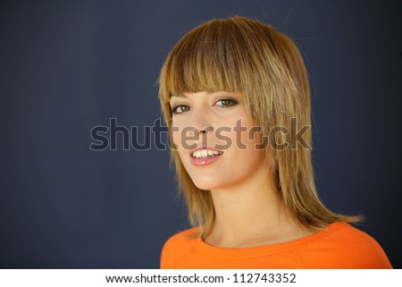 Portrait of a young woman with layered hair