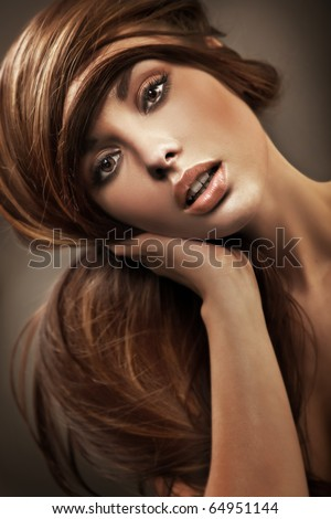 Portrait of a young woman with long hair - stock photo