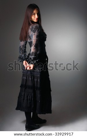 Portrait of a young woman with long hair. She's ashamed